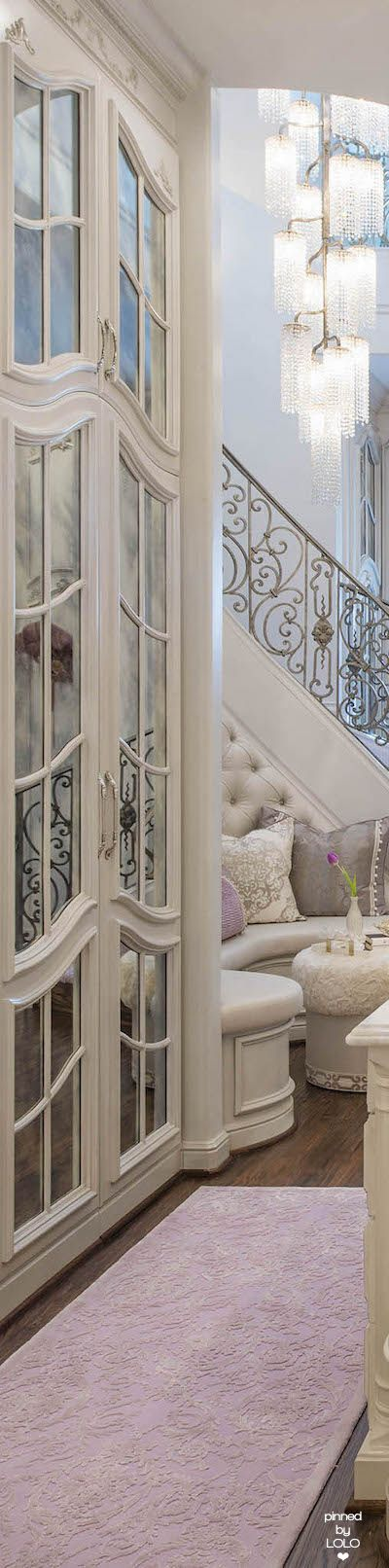 Mediterranean luxury home in light colors. on-trend cool neutral decorating with transitional lighting