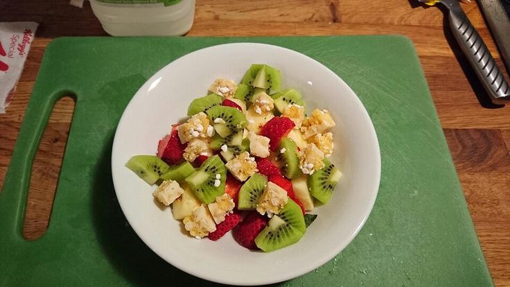 Sunshine breakfast. Strawberries, Pineapple and Kiwi fruit with Lemon Meringue Hi Fi light chopped through.