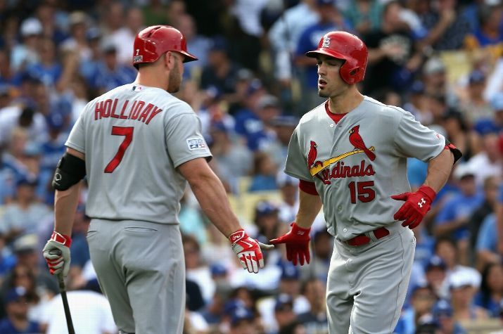 LOS ANGELES, CA - OCTOBER 03: Randal Grichuk #15 of the St. Louis Cardinals celebrates with teammate Matt Holliday #7 after hitting a homerun to score in the first inning of Game One of the National League Division Series at Dodger Stadium on October 3, 2014 in Los Angeles, California. (Photo by Stephen Dunn/Getty Images)