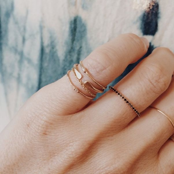 small dainty rings stacked on pinky