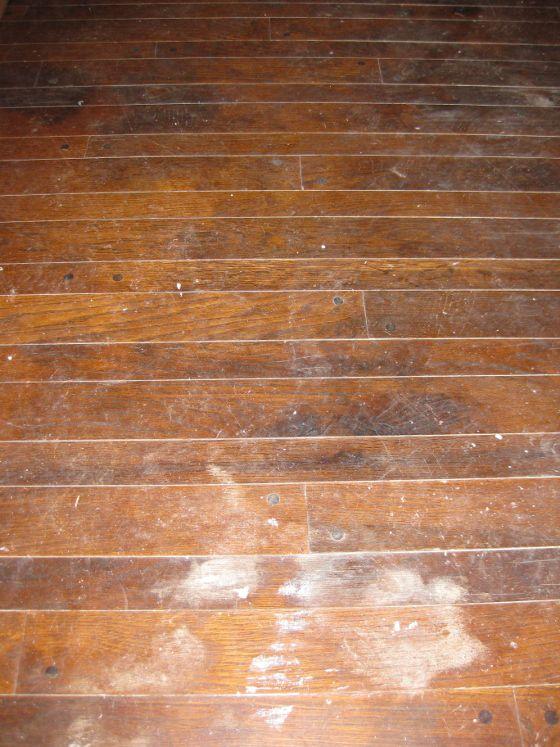 Worn and damaged varnished wooden floor