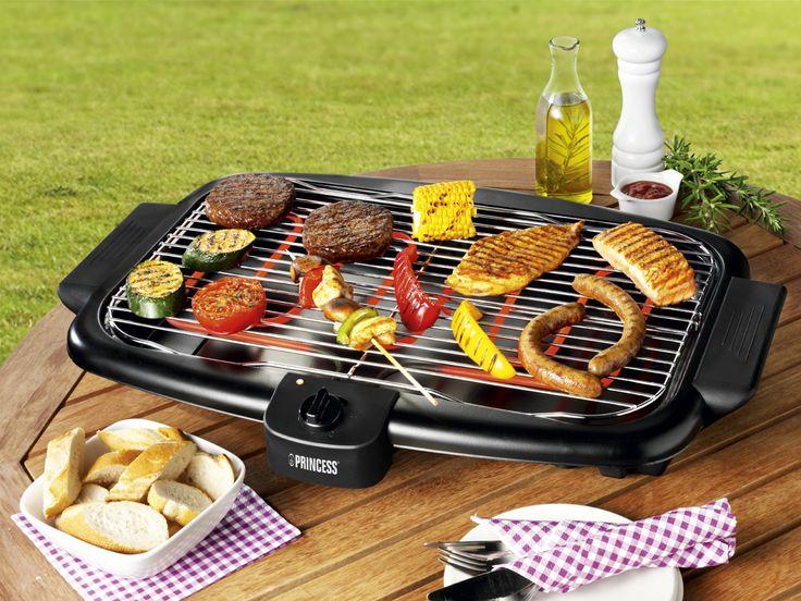 Barbecue elettrico con griglia e vaschetta raccogli liquidi, ideale per la cottura dei cibi all'interno dell'abitazione