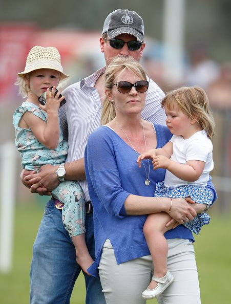 Isla Phillips, Peter Phillips, Autumn Phillips and Mia Tindall watch Zara Tindall compete in the cross country phase of the Badminton Horse Trials on May 7, 2016 in Badminton, England.