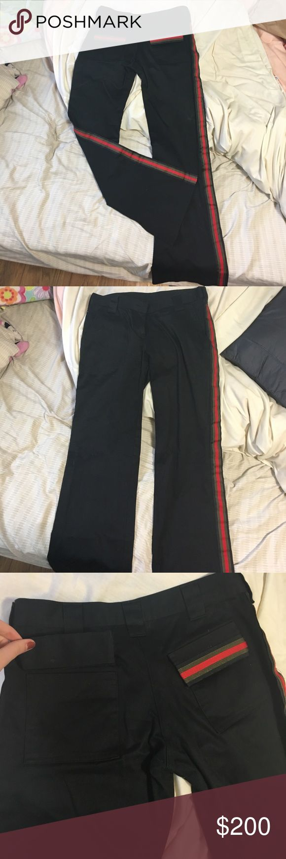 Celebrity clothing designer pants Says size 0 but fits like a 6. Slim flare cut, black pants with green black and red side stripes. One belt loop was re sewn down with blue thread. .............These are by celebrity clothing designer Perry White. I'll link his twitter. There are 6 inch slit details on the inside of each ankle. .......Tagged AM for visibility ..........https://mobile.twitter.com/perrywhitela?lang=en Alexander McQueen Pants Boot Cut & Flare