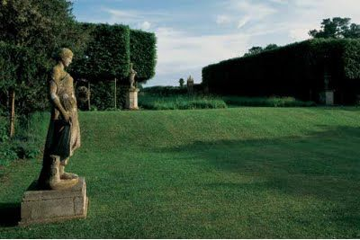 Statues in the garden at The Grove, the home of interior designer, David Hicks