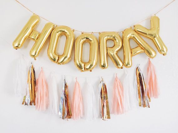 HOORAY gold letter balloon banner SETS Lightweight and can be easily displayed on walls, tables, and outdoors.  **Reusable! Balloons can be re-inflated once they start to lose air over time but they cannot deflate completely for flat storage**  Perfect for: - displaying under a table - hanging against a wall - the outdoors, on trees, fences, brick walls - super cute photobooth back drop - dessert table decor  Listing Includes: - includes 6 self-sealing balloons that spell out HOORAY (16…