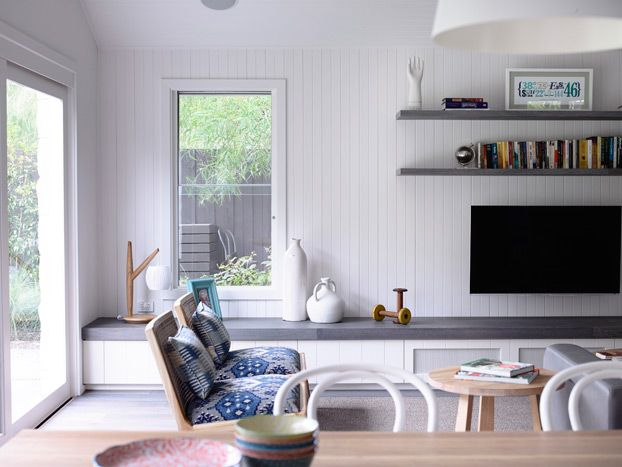 Built in Bench with shelves above TV.
