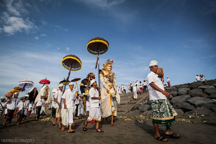 Melasti beach procession at Padang Galak beach in Bali. A glorious celebration found in Balinese culture which takes place annually 3 days before the Balinese New Year (Nyepi) and sees hundreds of Hindu devotees visiting the nearest source of water en masse to carry out this traditional ritual in Indonesia  #melasti #bali #ceremonies #photography #travel #nomadicimagery
