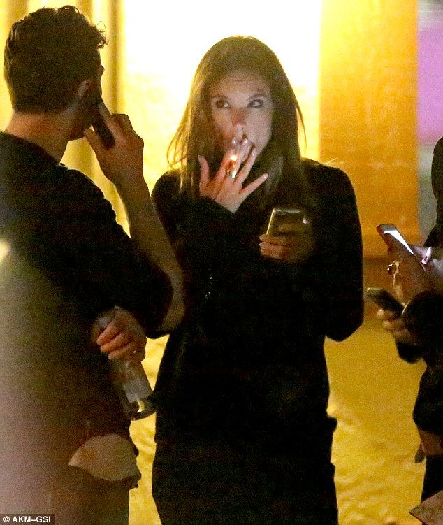 Smoking! Alessandra Ambrosio lights up a cigarette outside Tao nightclub in Phoenix on Sun...