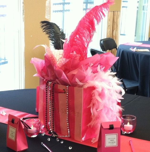 good centerpiece idea-make sure the feather is not too tall, and different solid color gift bag