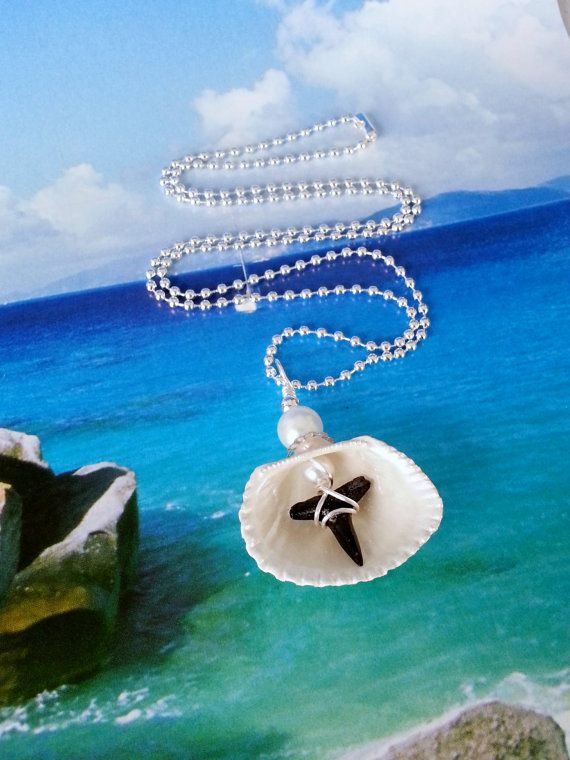 Hey, I found this really awesome Etsy listing at https://www.etsy.com/listing/265224772/reversible-seashell-shark-tooth-necklace
