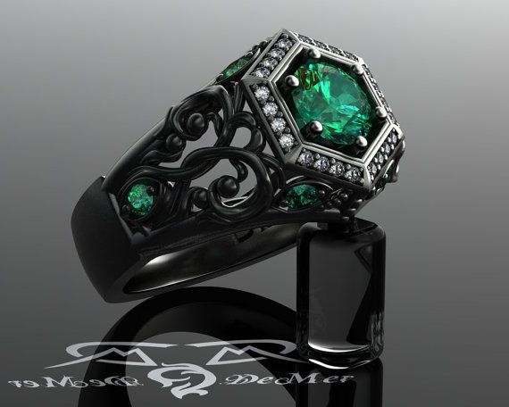 Unique emerald engagement ring in black gold. Art by DeMerJewelry