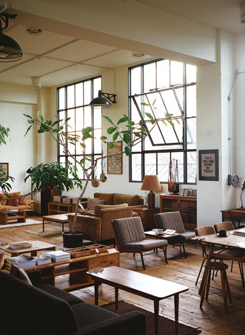 A little cluttered with too much furniture, but I kind of like the industrial/mid-century modern mash up in here. Those windows, the floor, and the high ceilings are killer.