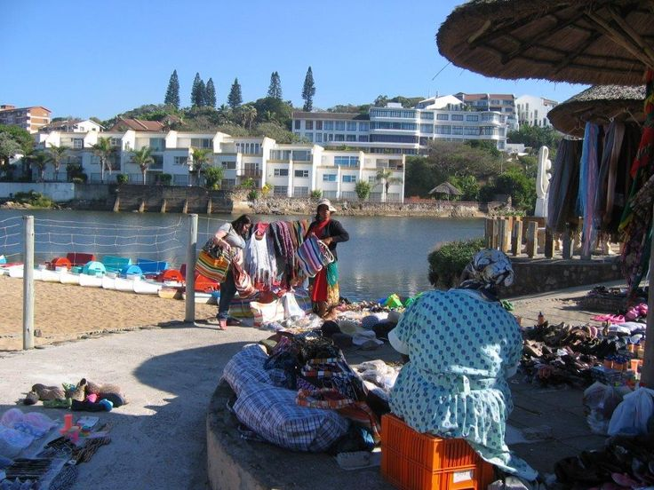 A colourful scene of vendors selling their wares near the Ramsgate lagoon