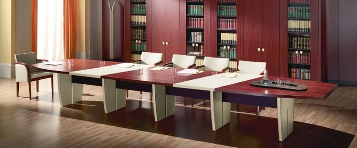 Codutti Offices - Classical Executive Collection Minos The classic for those who want to stand out. Thanks especially to fine materials: Bubinga wood with its typical dark reddish natural colour, saddle-stitched leather in blue petrol, ochre or in the exclusive iguana finish, and Murano red glass. The refinement of the whole collection that is rooted in Codutti's past in naval furnishing, creating interiors with a timeless charm. http://www.codutti.it/eng/products/executive/minos