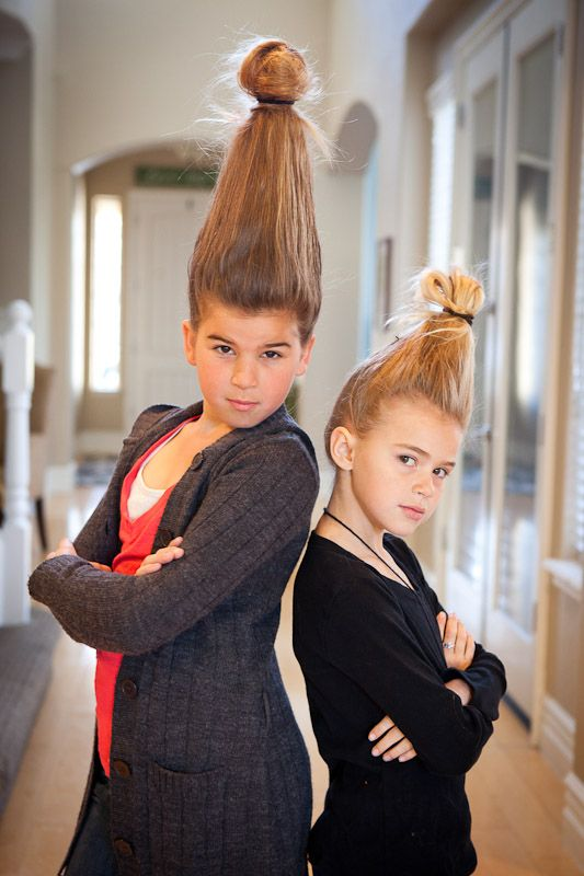 """Fun """"Wacky Hair Day"""" idea. Empty water bottle on head and hair pulled up to cover it. So silly."""
