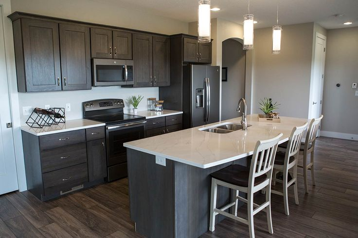 Aspect - #Lancaster Poplar cabinets with #Hanstone Basento countertops. All GE Slate appliances. All nickel hardware finish.
