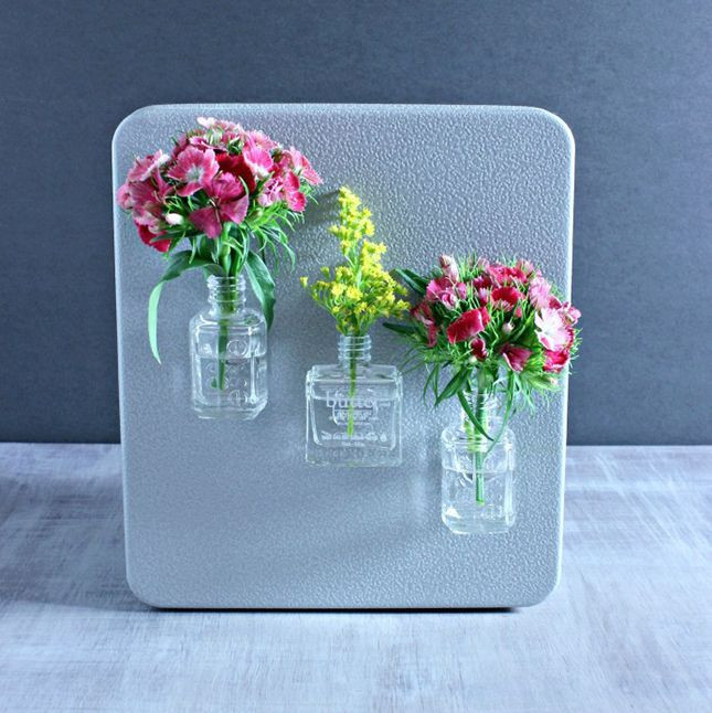 Turn empty nail polish bottles into magnetic fridge vases with this tutorial.