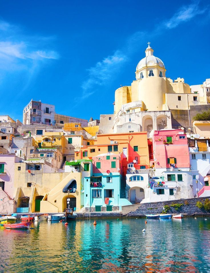 Procida is the quintessential Mediterranean paradise, an absolute vision of colorful harborside homes and picturesque piazzas. The coast is filled with the cutest pastel-colored houses.