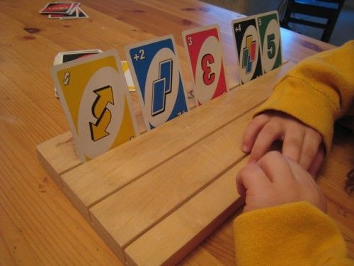 Make Card Boards for little hands to play games - This card holding board is great for little hands to play the game without too much fumbling. Easy directions to make these yourself at home.