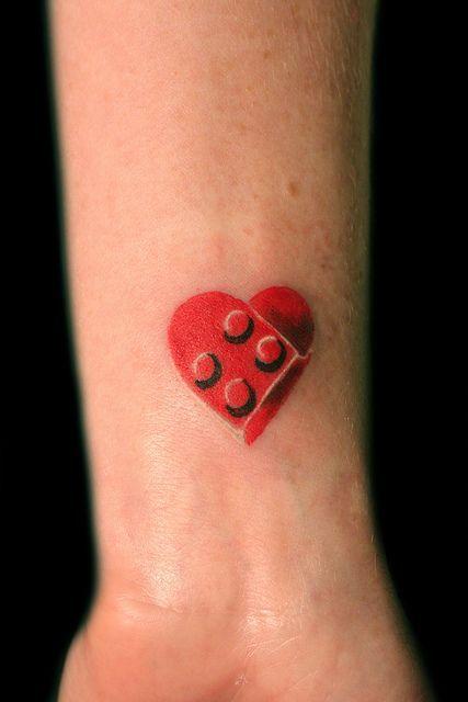 Lego heart Tattoo was done by Crutch @ Tattoo Boogaloo, 528 Green st, San Francisco Ca. #415-391-1053