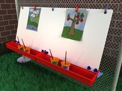 Let children them express their artistic side at school with the convenient Double Fence Easel. The easel comes complete with S-hooks for hanging on a chain-link fence, Clamps to secure paper, Easel T