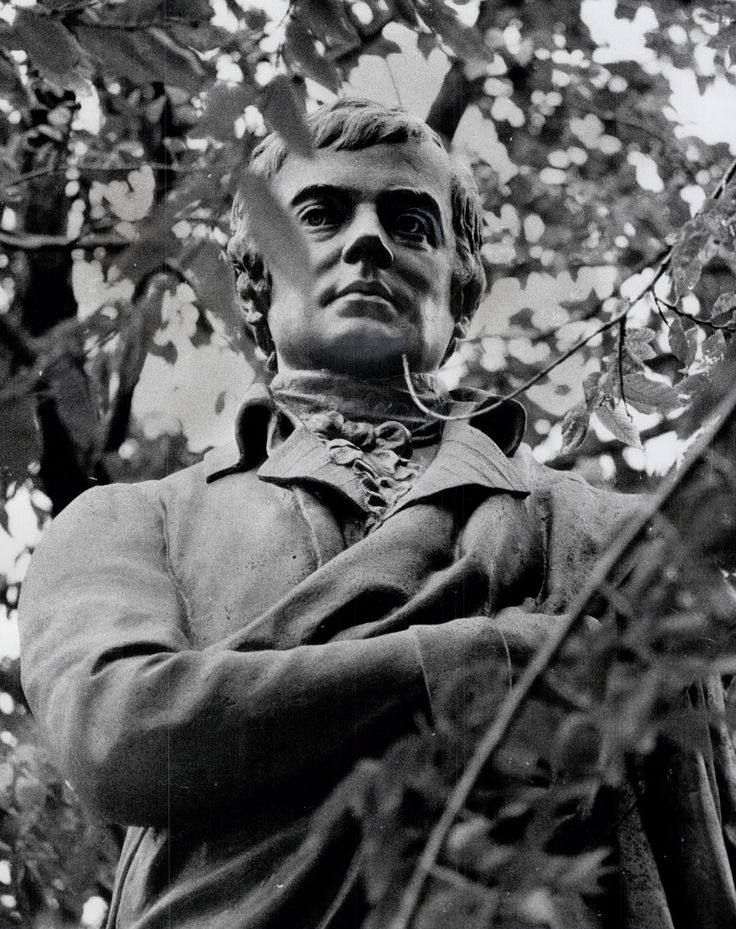 """Toronto's statue of """"the People's Poet"""" himself, Robbie Burns (1759-1796), as it stood in 1972. The David Walter Stevenson sculpture was erected in Allan Gardens in 1902, but 70 years later it had begun to lose its war with the local shrubbery. Since rescued from his distress, he can still be seen in the park, where the local St. Andrew's Society holds their annual memorial next Thursday (11:30 am). So, if you can't make it, maybe """"raise a cup o'kindness"""" for """"auld lang syne"""", my dears."""