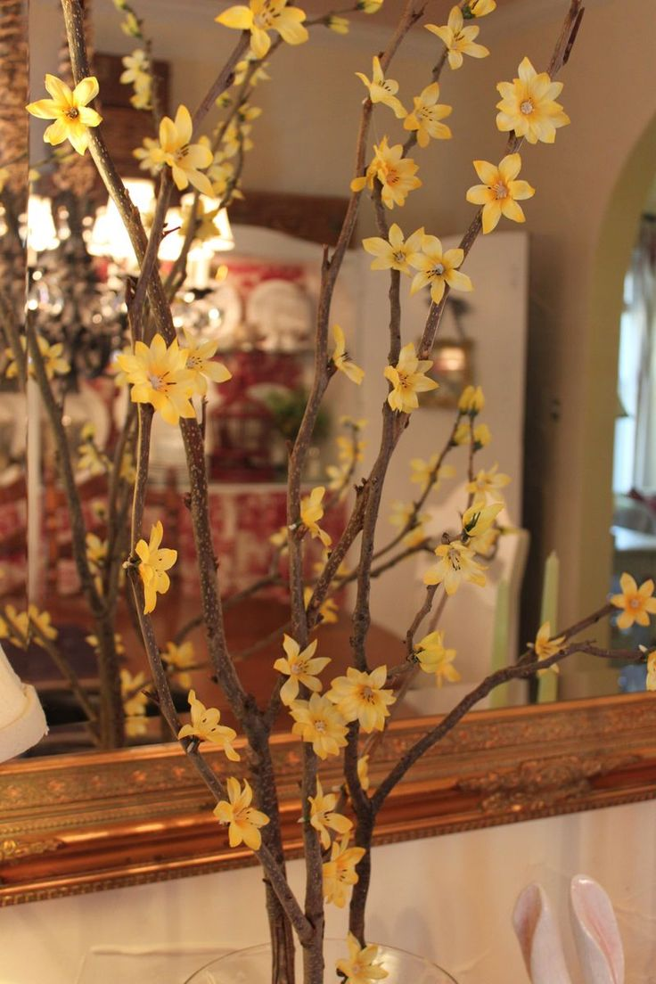 DIY real branches, faux flowers...cute.