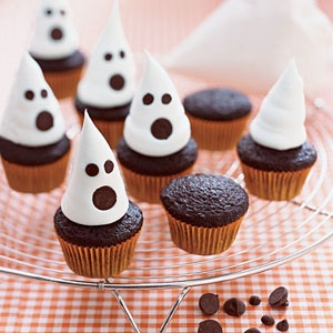 Mini Ghost Cupcakes    Decorate mini chocolate cupcakes for Halloween treats by topping them with whipped topping ghosts and chocolate chip faces.