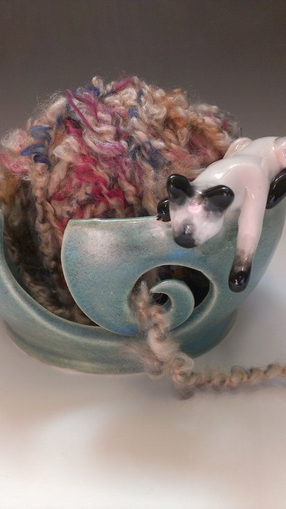 Kitty Yarn Bowl  Made to Order by rabbitmeadowstudio on Etsy, $40.00 --- Except I would like the kitty to look more like my cat, Chloe, who is a tortoiseshell cat, not a Siamese. :)