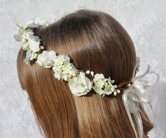 Ivory hydrangea and sweet pea flowers with white berries handmade into a wreath for your flower girl or for her first communion. This wreath is shown in ivory tones, but can be made similarly in bridal white as well. Please measure your childs head where you want the wreath to sit