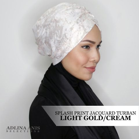 SPLASH PRINT JACQUARD TURBAN - LIGHT GOLD/CREAM  $45.00 SGD  Limited Edition Slip-on Turban  Size: Fits small to medium  You'll find only the best hijabs / tudungs / scarves that are shipped worldwide.  Click through to the website to find out more.