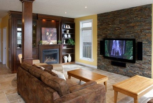 tv on accent wall with rock - Google Search