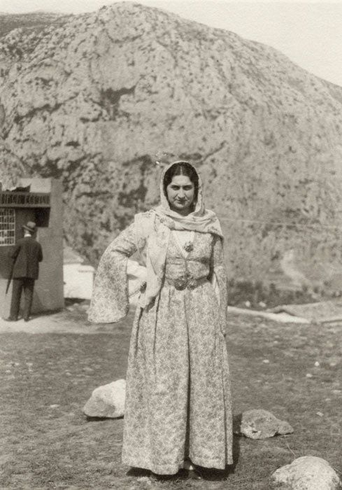 I think maybe Samos costume...  The Athenian Virginia Romanos at the Delphic Festival of 1930.  The Delphic Rock is visible  behind her.  Photograph by Nelly's.  Alexandros Romanos Archive