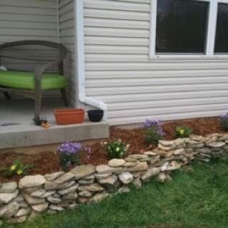 Creek rock flower bed