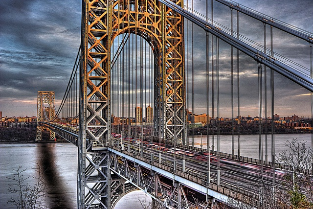 The George Washington Bridge (GWB) crosses Hudson River connecting Fort Lee in Bergen County, New Jersey and Washington Heights, Manhattan in New York City Designer:	Othmar Ammann, Cass Gilbert Design: Double-decked Suspension bridge, Material:	Steel, Construction: 1927-1931, Total length	4,760 ft (1,450 m) Width	119 ft (36 m) Height	604 ft (184 m) Longest span	3,500 ft (1,100 m)