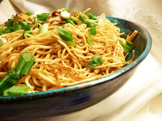 My grandmother was born in Indonesia and growing up we awaited the next time she would make Bami Goreng- Fried Noodles.  She made it with pork, but since I no longer eat pork I substitute chicken here. This is the basic version. You can add any vegetable you like. I add tiny frozen peas and carrots for color, or red or yellow bell pepper thinly sliced using a mandolin.