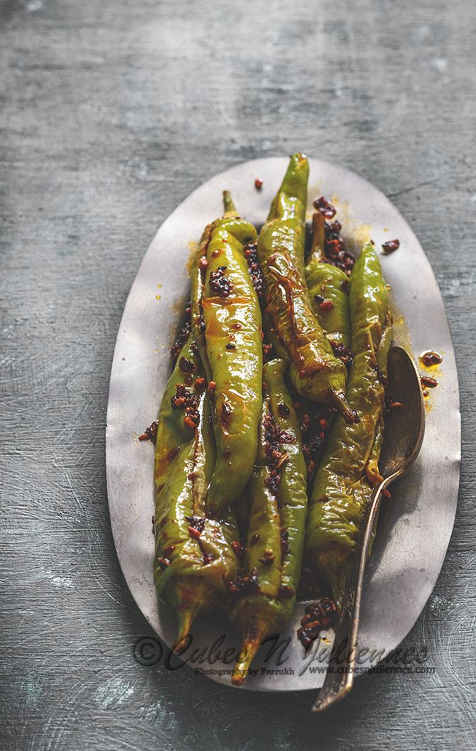 Green chilies fried with pickle spices