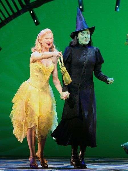 Lucy Scherer as Galinda and Willemijn Verkaik as Elphaba. Although Galinda and Elphaba aren't friends in this story, and Galinda hasn't given Elphaba that hat, this is a great reference image for Elphaba in her excitement over being in the Emerald City.