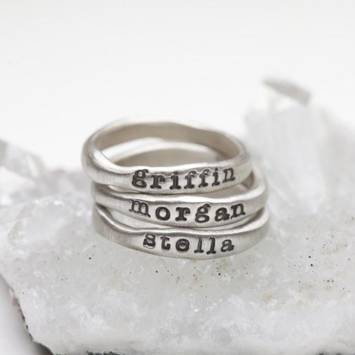 Oh my goodness these are gorgeous! Hand-molded and cast in sterling silver, these rings have a beautiful organic shape and feel. Each ring has a hammered texture. Customize your ring with a special name or short phrase and stack them up for an up-to-date