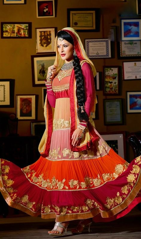 Set a new standard in elegance with this multicolor faux georgette flared Anarkali suit. You'll be able to see some intriguing patterns completed with floral patch, lace, resham and stones work. #UniqueDesignerWear