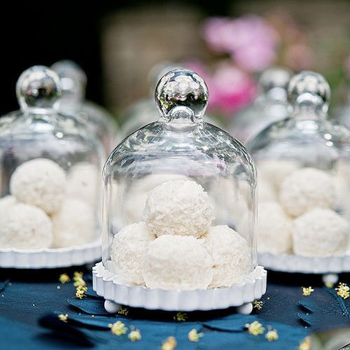 Mini Glass Bell Jars with Base filled with coconut cookies favors. Great idea for a winter wedding or Christmas festivities.