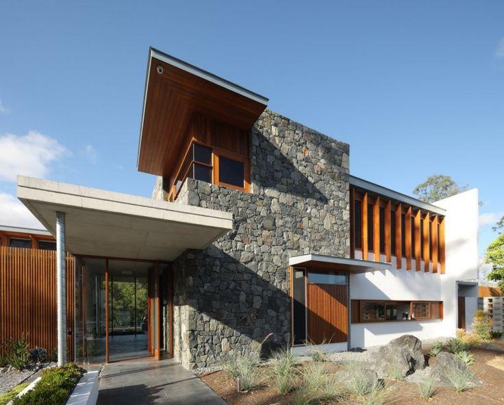 Shaun Lockyer Architects have designed a house named One Wybelenna in Brisbane, Australia.  multiple medley mix elevation materials, modern, simple, boxy, stone, stucco, wood, metal, zinc, tallowwood, slate, travertine