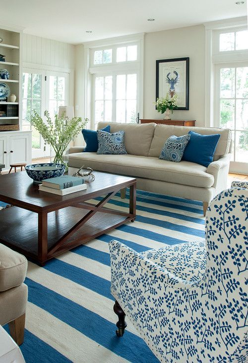 Prints and patterns in a blue and white beach bungalow.