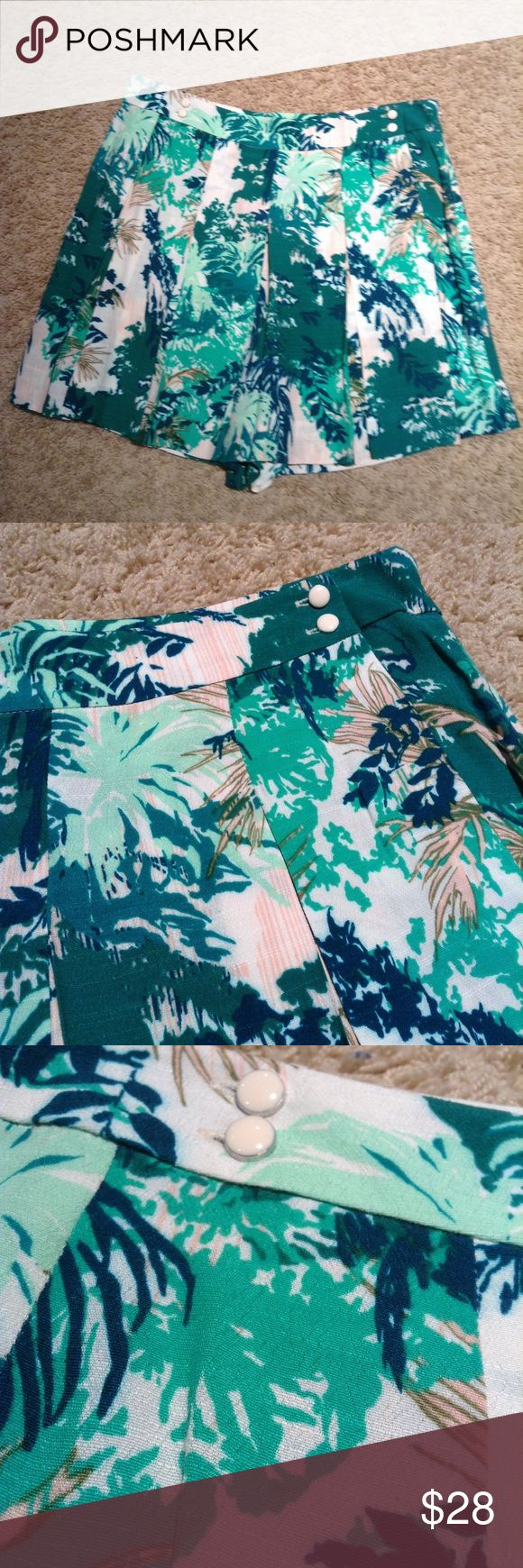 elevenses ANTHROPOLOGIE tropical print skort 4 Tropical print skort (skirted shorts) from Elevenses, sold only at Anthropologie. 100% rayon, lined in the back, and machine washable. Picture 4 shows these are normal shorts, and then have a skirted overlay in front. Hidden side zip closure. I see there is also supposed to be a hook/ eye closure on the inside top of the zipper, but the 'hook' part has come off. Easy fix, or totally wearable as-is. Otherwise like-new condition! Tagged as a 4…