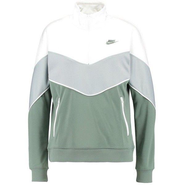 2422e83c Nike Sportswear SOLID Sweatshirt ($84) ❤ liked on Polyvore featuring tops,  hoodies, sweatshirts, green top, nike, green sweatshirt, nike sweatshirts  and ...