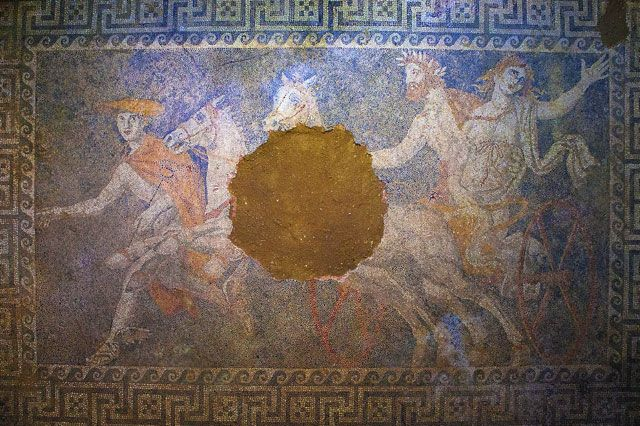 More digging revealed a third figure: Persephone. It's clear that this scene shows the goddess being taken into the underworld by Hades.