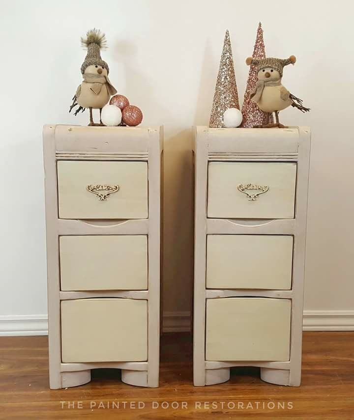 Vintage Night Stands. Bodies in Fusion Mineral Paints Little Stork, then distressed and glazed with Cottage Paints Umber Glaze. Drawers in Fusion's Raw Silk, distressed and glazed in Cottage Paints Umber Glaze. Bird applique applied to top drawers.  Feather stencil on the top of each table in Raw Silk and small feathers stencilled on drawer sides in Little Stork. www.facebook.com/thepainteddoorrestorations