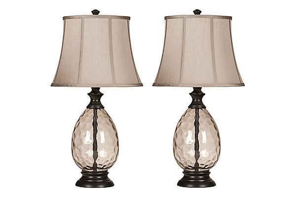 The Olivia Table Lamp (Set of 2) from Ashley Furniture HomeStore (AFHS.com). A smoky glass and bronze finished table lamp topped with a bell shade and features a 3-way switch.
