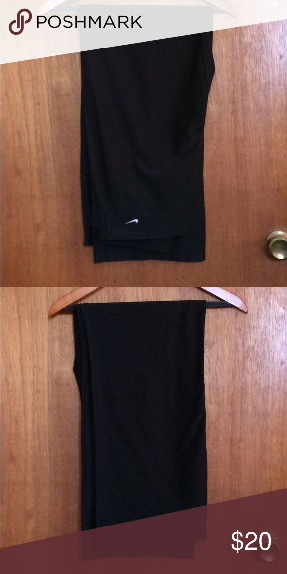 "Nike Dri Fit Solid Black Track Pants, 32"" Inseam One pair of Nike sport pants. These look like sweatpants, but are made out of nylon. Leg openings are not tight  fitting. They are supposed to be a little loose. In excellent used condition. 32 inch inseam. Nike logo on left hip. Pants Track Pants & Joggers"